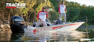Tracker boats Pro Team 195 guy pulling fish into boat